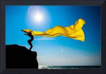 girl with yellow fabric against the sky