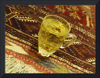 Green Tea On Afghan Carpet