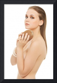 Attractive nude woman with coconut. Isolated on wh