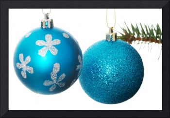 Two blue christmas balls handing on a fir. Isolate