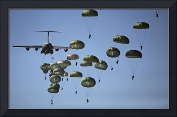 U.S. Army paratroopers jumping out of a C-17 Globe