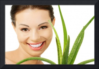 Young beautiful woman's face and aloe vera. Isolat