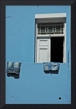 blue jeans on a blue wall