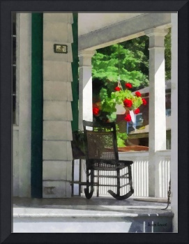 Porch With Rocking Chair and Geraniums
