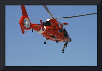 An HH 65C Dolphin demonstrates a helicopter rescue
