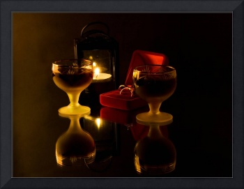 Romantic still life with wineglass gold ring in re