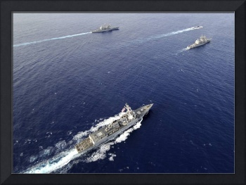 Aerial view of a naval fleet transiting the Pacifi
