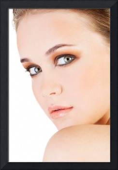 Attractive young woman's face. Closeup. Isolated o