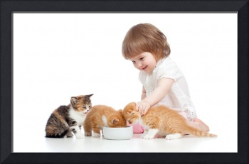 Little Girl Feeds Her Kittens