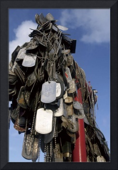 Dog tags from Marines and sailors hang in front of
