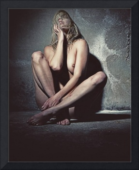 Naked woman in a dark cellar. Image finished with