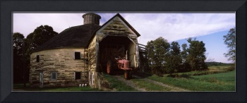 Tractor parked inside of a round barn