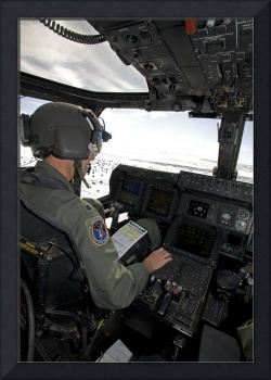 Pilot of a CV-22 Osprey goes over his instruments