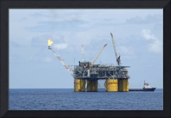 Offshore oil production platform with flare