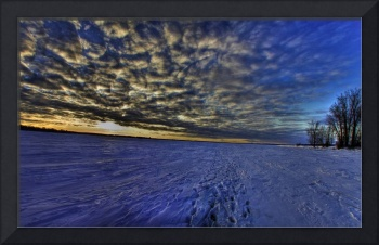 Sky showing clouds and footsteps to frozen river