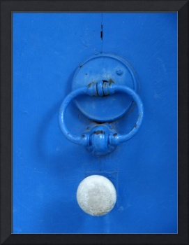 White Door Knob on Blue Door