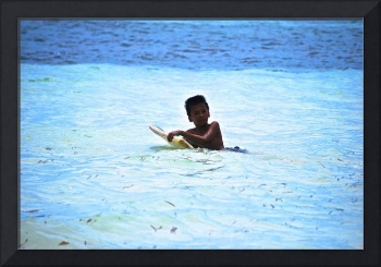 Palauan boy braving waters on bodyboard, Long Beac