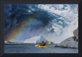 A kayaker explores a melt stream gushing from bene