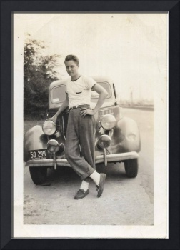 boy posing standing in front of antique car 1944 I