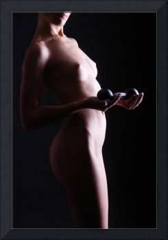 Nude woman with dumbbell