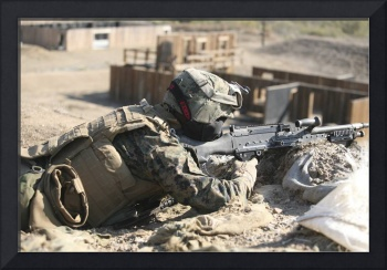 U.S. Marines train for a sniper encounter at Camp