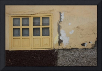 Yellow Shuttered Window in a Wall