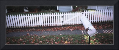 Mailbox in front of a picket fence
