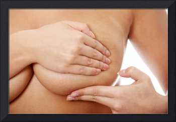 Young caucasian adult woman examining her breast.