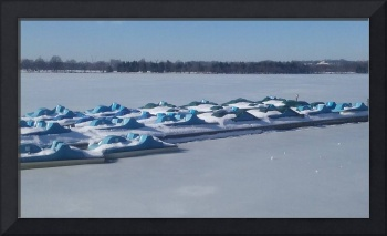 Paddle Boats under a Snow Blanket