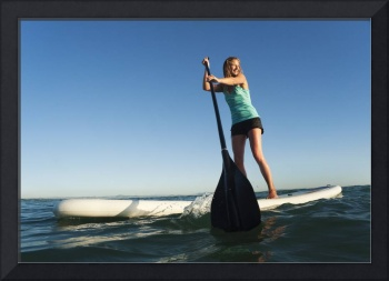 Woman Paddling While Standing On Surf Board, Tarif