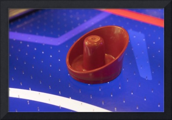 Red Air Hockey Paddle On Blue Table