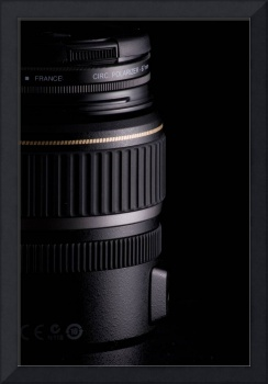 Close up of modern camera lens on black background