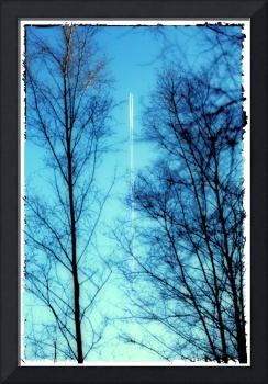 Distant Airplane in Blue Sky