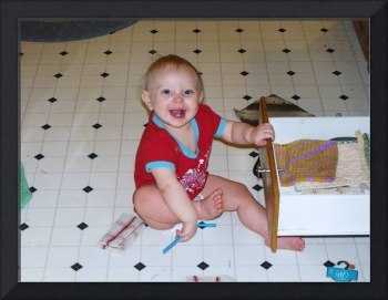 Baby cleaning kitchen