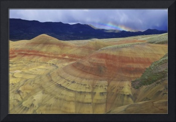 Small rainbow appears behind a Painted Hill