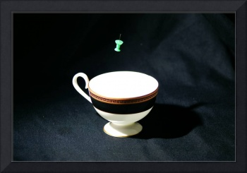 green thumbtack and fine bone china cup