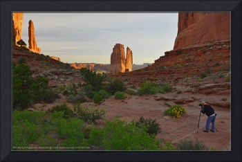 Photographer in Arches National Park at sunrise
