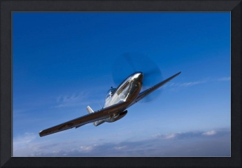 A North American P-51D Mustang in flight near Chin