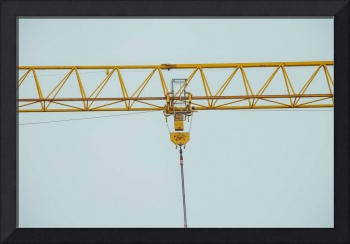 Closeup on part of yellow construction crane chain