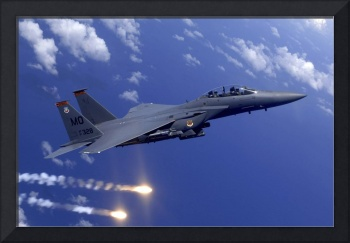 An Air Force F15E Strike Eagle fires flares off th