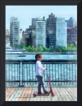 Manhattan New York - Little Girl on Scooter by Man