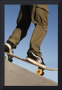 Low Angle View Of Young Male Skateboarder