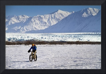 Man Fat Tire Mountain Biking On The Knik Glacier,