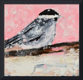 Pink chickadee bird in snowstorm