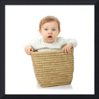 Young baby girl in basket