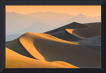 Sand dunes over sunrise sky in death valley