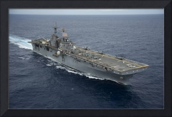 The amphibious assault ship USS Essex transits the