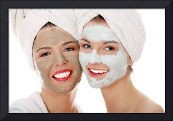 Young happy women with facial clay mask.
