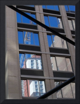 Construction crane reflected in many windows