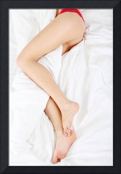 Woman legs on bed.